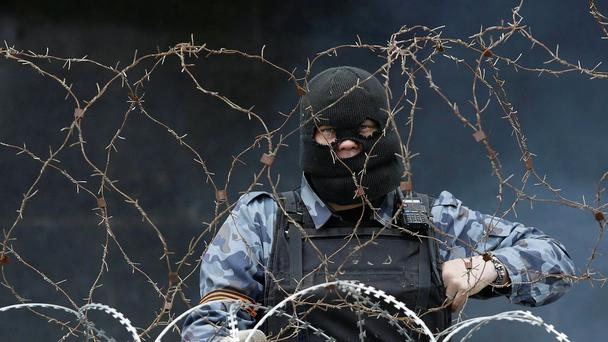 A pro-Russia protester at a barricade outside a regional government building in Donetsk.