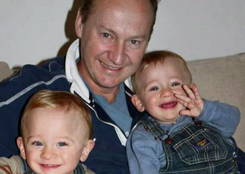 Gary Clarence with his twin sons