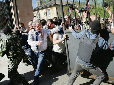 Pro-Russian activists break through the gate in front of TRK Donbass TV station in Donetsk, Ukraine. Getty Images/Scott Olson