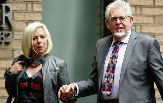 Artist and television personality Rolf Harris arrives with daughter Bindi Harris at Southwark Crown Court in London