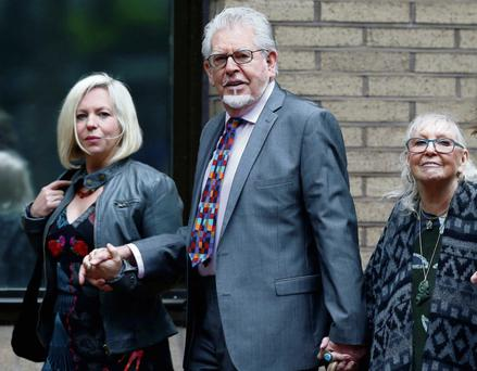 Entertainer Rolf Harris arrives at Southwark Crown Court, with his daughter Bindi (L) and wife Alwen (2nd R), in London. Harris is charged with indecent assault, and denies the charges