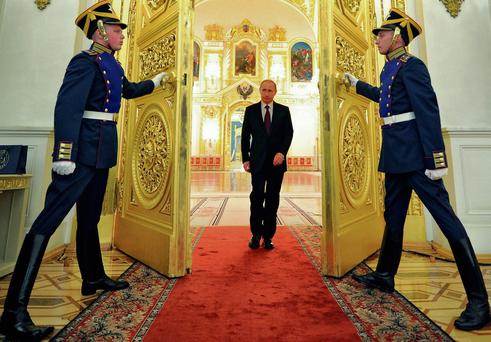 Russian President Vladimir Putin enters a hall to attend the presentation ceremony of the top military brass in the Kremlin in Moscow. Photo: Alexei Druzhinin