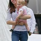 Kate Middleton with her son Prince George yesterday.