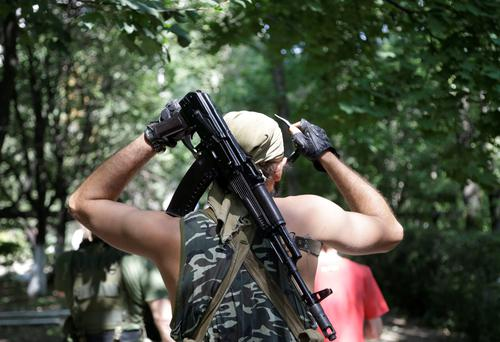 A Pro-Russian rebel adjusts his weapon in Donetsk, eastern Ukraine. Air strikes and artillery fire between pro-Russian separatists and Ukrainian troops in the eastern city of Donetsk have brought the violence closer than ever to the city center, as Kiev's forces move in on the rebel stronghold