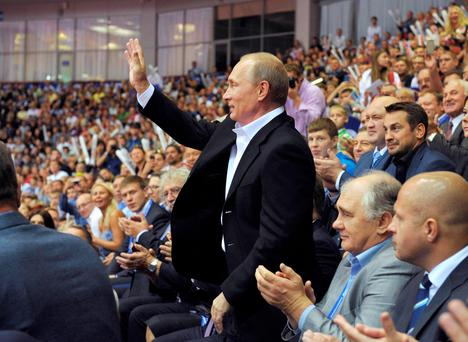 Russian President Vladimir Putin greets spectators at the 2014 World Judo Championships in Chelyabinsk yesterday.