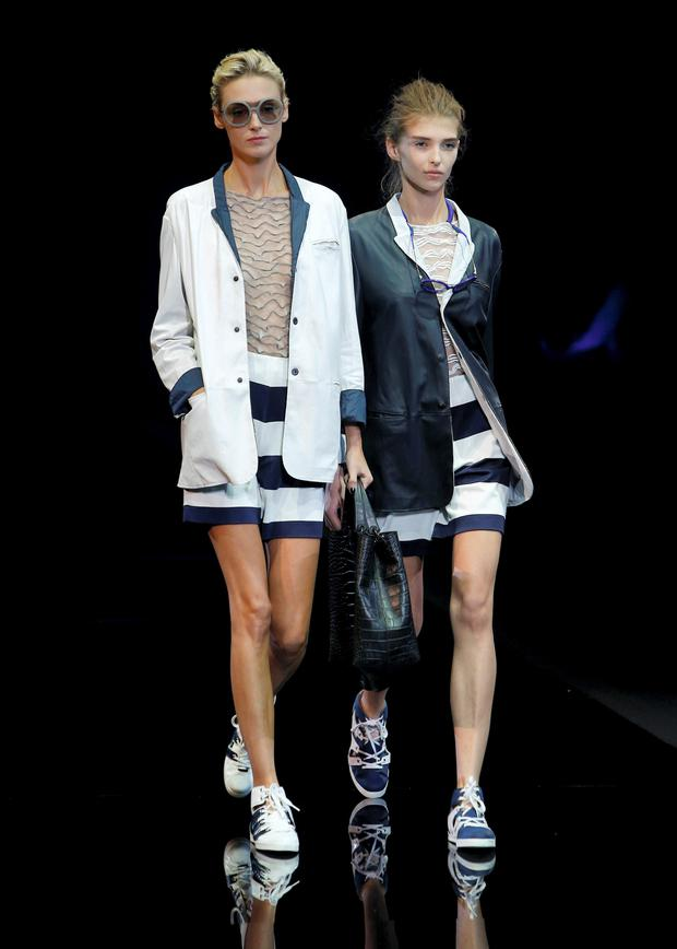 Models present creations from Emporio Armani Spring/Summer 2015 collection during Milan Fashion Week .