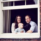 5. To celebrate his birth, William and Kate shared this portrait with George and their dog Lupo.