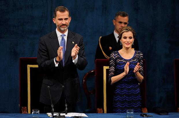 Spain's King Felipe VI and Queen Letizia clap during the ceremony for the Prince of Asturias Awards in Oviedo. The awards are held annually since 1981 to reward scientific, technical, cultural, social and humanitarian work done by individuals, work teams and institutions