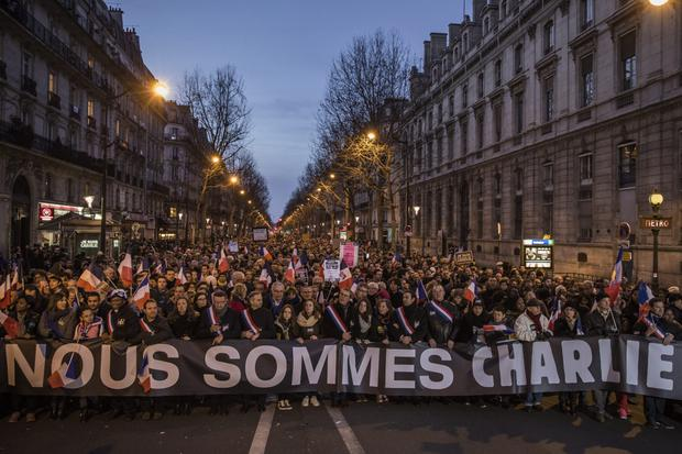 Demonstrators make their way along Place de la Republique during a mass unity rally