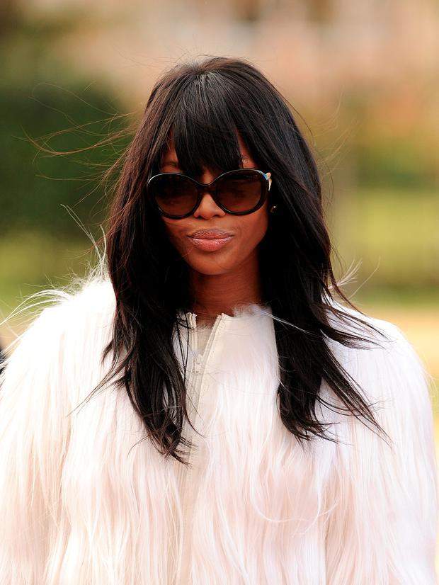 Naomi Campbell arriving for the Burberry Prorsum womenswear catwalk show at Kesington Gardens