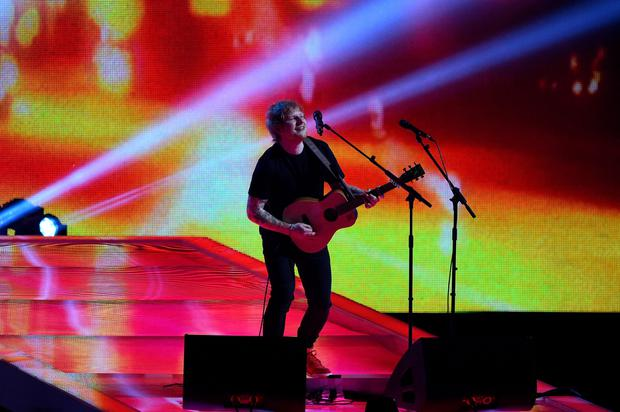 Ed Sheeran performs on stage during the BRIT Awards 2015