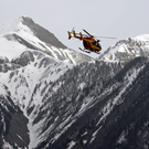 A rescue helicopter from the French Securite Civile flies over the French Alps during after the crash of the Airbus A320, near Seyne-les-Alpes yesterday in which 150 people were killed.