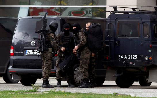 Turkish special forces outside the Justice Palace in Istanbul where two gunmen took a hostage