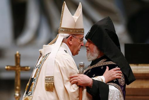 Pope Francis embraces Catholicos of All Armenians Karekin II during a mass on the 100th anniversary of the Armenian mass killings, in St Peter's Basilica at the Vatican