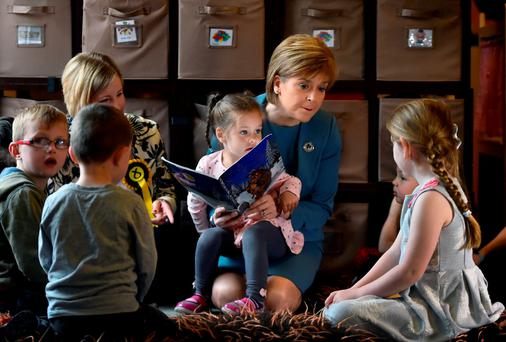 Scottish First Minister and leader of the SNP Nicola Sturgeon and candidate Hannah Bardell (left) visiting a nursery while campaigning in the UK general election