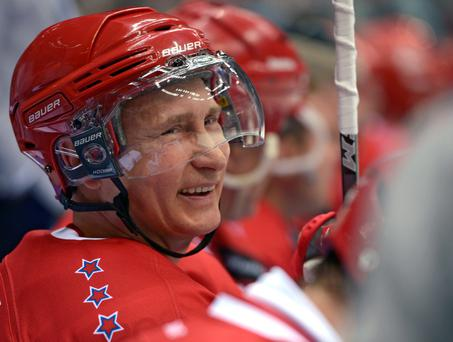 President Vladimir Putin smiles during an exhibition hockey game at a tournament of the Night Hockey League
