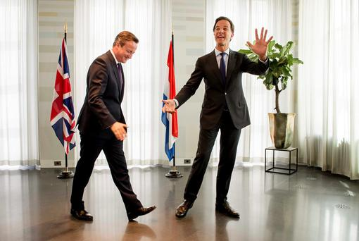Prime Minister of the Netherlands Mark Rutte (right) welcomes British Prime Minister David Cameron to his official residence Catshuis in The Hague