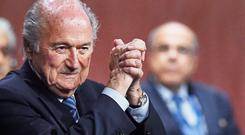A delighted Sepp Blatter exults in his victory after the vote that confirmed him as head of Fifa for a fifth time