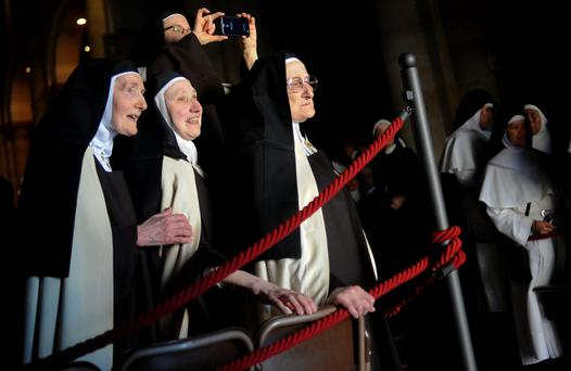 Nuns wait for the arrival of Pope Francis to look at the Shroud of Turin