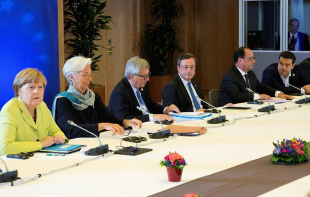 (L-R) German Chancellor Angela Merkel, International Monetary Fund (IMF) Managing Director Christine Lagarde, European Commission President Jean-Claude Juncker, European Central Bank President Mario Draghi, French President Francois Hollande and Greek Prime Minister Alexis Tsipras attend a Eurozone emergency summit on Greece in Brussels