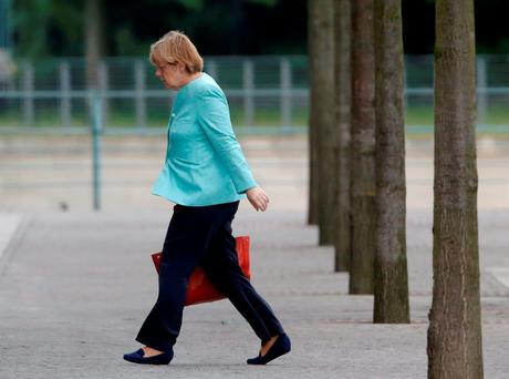 German Chancellor Angela Merkel arrives at the Chancellery in Berlin yesterday