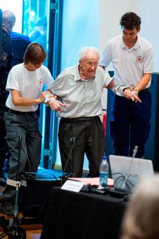 Defendant and German former SS officer Oskar Groening (C), 94, dubbed the