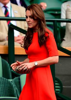 Princess Kate, right, makes her way to the Royal Box at Wimbledon Centre Court to join David and Romeo Beckham for Andy Murray's victory over Vasek Pospisil