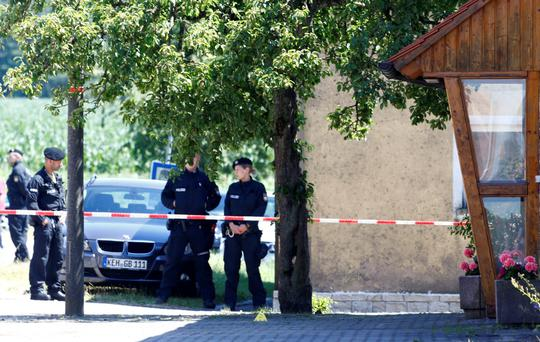 German police officer guard a crime scene iin Tiefenthal.