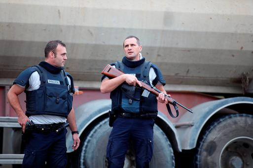 An armed riot police officer at the scene in Villeneuve-la-Garenne