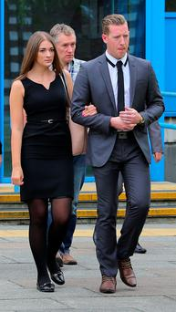 Family members of Don Lock leave Crawley Magistrates Court in West Sussex following the appearance of Matthew Daley