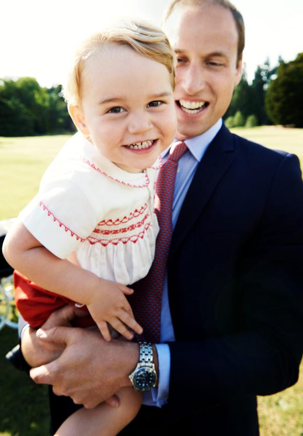 Prince William holds Prince George, who celebrated his second birthday yesterday, in this latest image from a series of family portraits taken earlier this month. Photo: Mario Testino