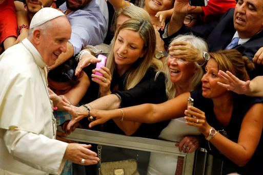 Pope Francis greets the faithful at an audience in the Vatican yesterday. Photo: Filippo Monteforte/Getty
