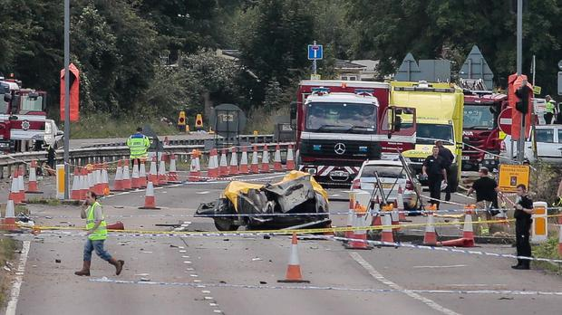 Horror scene: Emergency Services attend the scene after a jet crashed onto a busy road