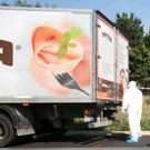The parked truck in which up to 50 migrants were found dead, on a motorway near Parndorf, Austria.