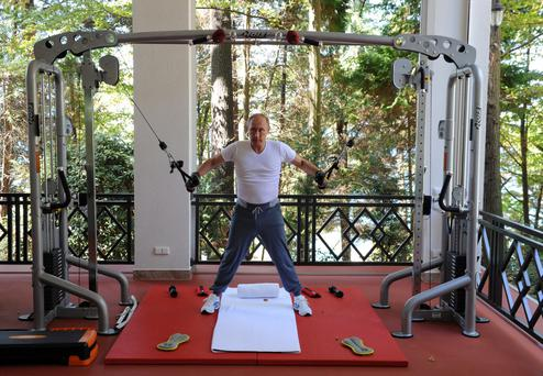 Russian President Vladimir Putin exercises in a gym at the Bocharov Ruchei state residence in Sochi, Russia