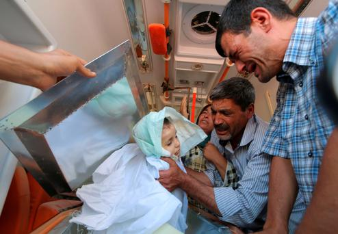 Relatives carry the body of Aylan Kurdi (3) during his funeral procession in Kobane, Syria
