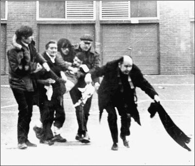 Father Edward Daly waves a blood-stained handkerchief on Bloody Sunday in Derry