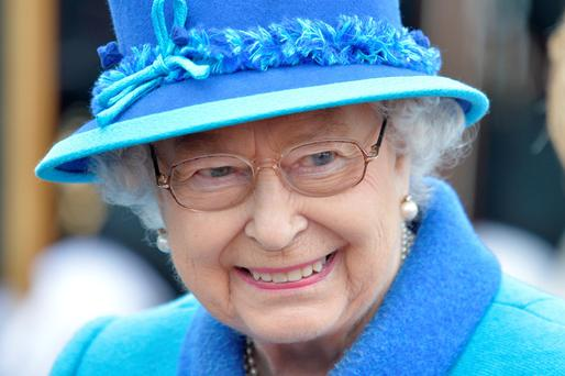 Queen Elizabeth smiles as she arrives at Tweedbank, Scotland, on the day she became Britain's longest-reigning monarch