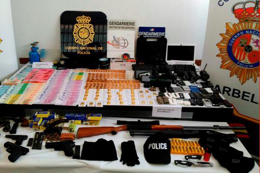 Gold ingots, guns and money seized by Spanish Police after arresting four French in the southern Spanish town of Marbella, accused of kidnapping a French businessman