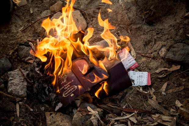 Refugees burn their passports before arriving in Athens