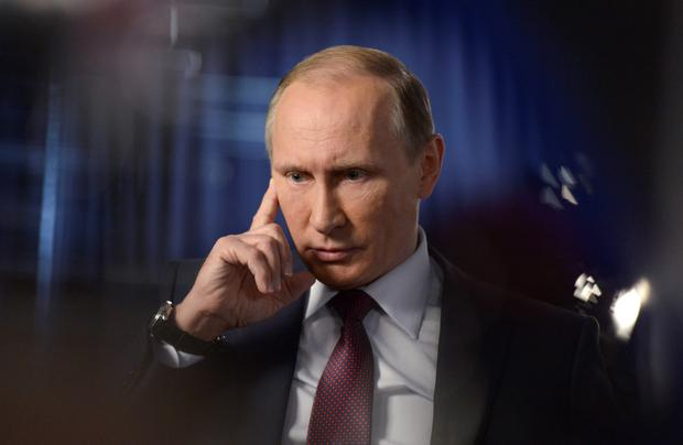 President Vladimir Putin answers questions during an interview for Russian television
