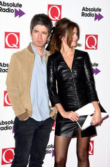 Noel Gallagher and wife Sara MacDonald attending the Q Awards.
