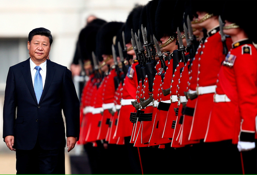China's President, Xi Jinping reviews an honour guard yesterday in London.