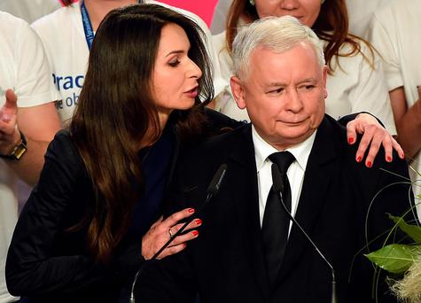 Jaroslaw Kaczynski (R), leader of the conservative opposition Law and Justice (PiS) is congratulated by Marta Kaczynska, daughter of late president Lech Kaczynsk.