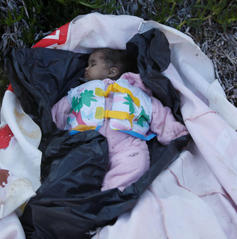 The body of a baby girl, who was said to have been onboard a wooden boat carrying refugees and migrants from Turkey to Greece that sank in open sea on Wednesday, is laid on blankets at a beach on the Greek island of Lesbos. The death toll from drownings at sea has mounted recently as weather in the Aegean has taken a turn for the worse
