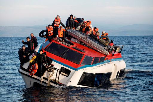 MORE WILL FOLLOW: Migrants sit atop a heavily-listing small vessel as they try to travel from Turkey to the northeastern Greek island of Lesbos