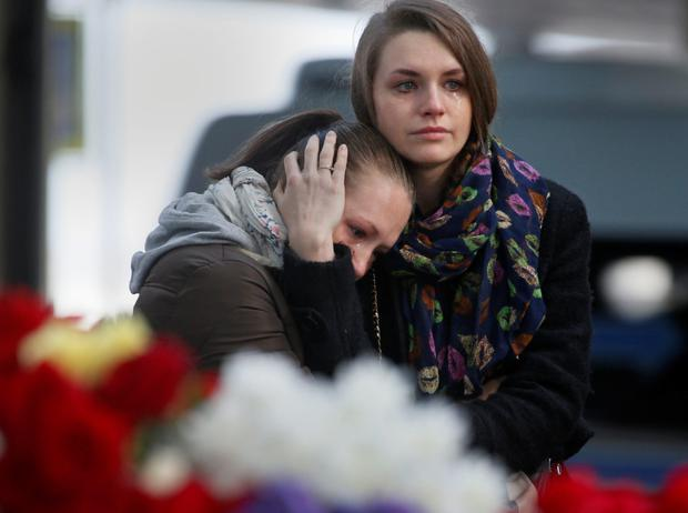Young women grieve at an entrance of Pulkovo airport outside St.Petersburg, Russia. Photo: AP