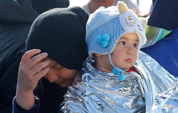 A mother holds her baby on board a Turkish coastguard ship after they were rescued following a failed attempt at crossing to the Greek island of Lesbos