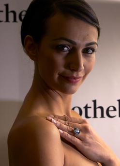 A Sotheby's employee displays the rare Blue Moon Diamond
