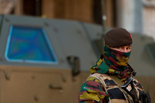 A soldier stands guard over Stadhuis Van Brussel in Grote Markt, Brussels